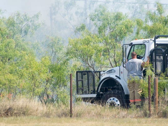 Quail Valley VFD truck 3 enters a field as flames lick closer to the fenceline. Multiple VFDs fought the brush fire that shut down Armstrong St. for several hours.