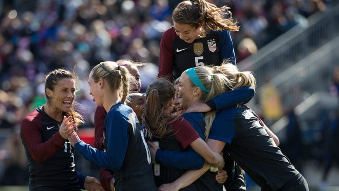 United States' Julie Johnston, center right, celebrates her second goal with teammates during the second half of an international friendly soccer match against Colombia, Sunday, April 10, 2016, in Chester, Pa. The United States won 3-0.