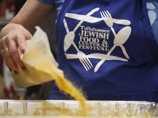 Volunteers work to create the 25 pans worth of Kugel for the thousands of expected attendees of Temple Israel's 7th Annual Tallahassee Jewish Food and Cultural Festival.