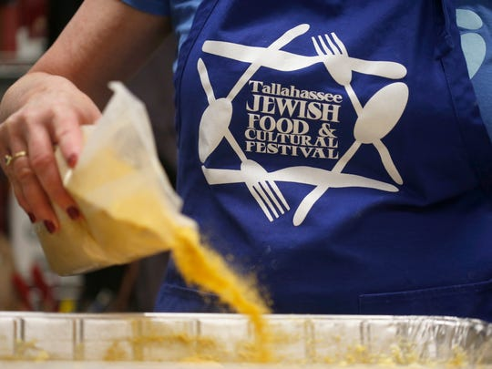 Volunteers work to create the 25 pans worth of Kugel