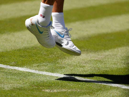 50bc046ad5142f Uniqlo apparel but still Nike shoes for Roger Federer.