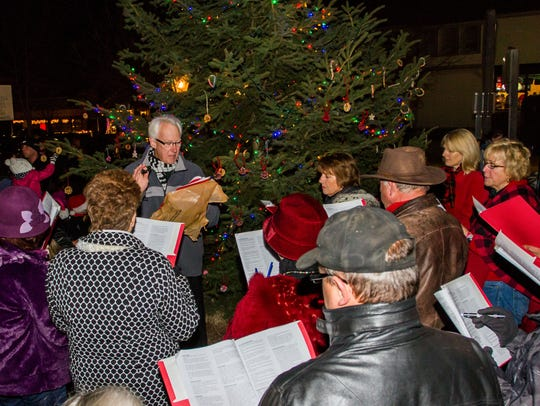 Carolers fill the night air with holiday songs during the annual Delafield tree lighting, which will take place from 5 to 6 p.m. Friday, Nov. 17, this year.
