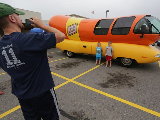 Jeff Ferg of Wausau photographs his two sons, Ty, 5,