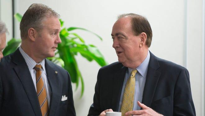 File photo shows Jay Jacobs, Auburn University athletic director, left, talking to Auburn University president Jay Gogue.