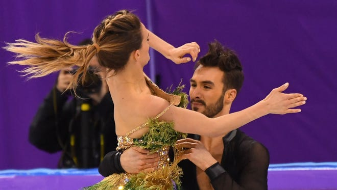 French ice dancer Gabriella Papadakis' dress became unfastened during her performance and she fought the rest of the way. Her partner is  Guillaume Cizeron.