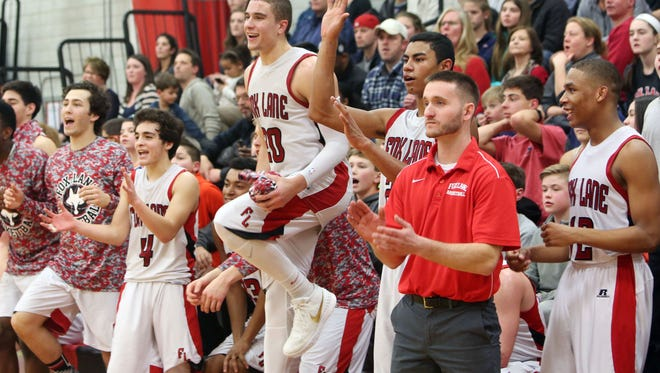 Fox Lane celebrates its 78-45 victory over New Rochelle in last year's Class AA quarterfinals at Fox Lane High School. The teams meet again in the same round at New Rochelle High School on Feb. 24, 2017.