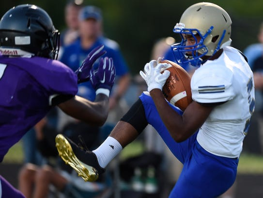 Brentwood wide receiver Chayce Bishop (5) pulls in