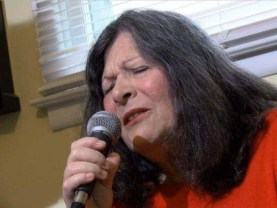 Rosemary Conte sings in the music room at her Matawan
