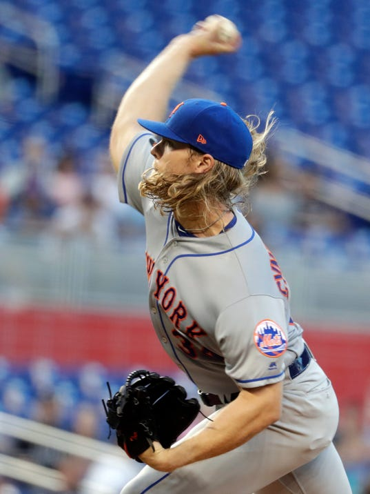 New York Mets starting pitcher Noah Syndergaard throws during the first inning of a baseball game against the Miami Marlins, Monday, April 9, 2018, in Miami. (AP Photo/Lynne Sladky)