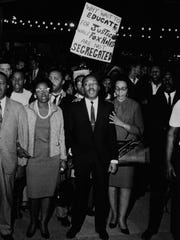 Rev. Martin Luther King Jr., center, and his wife, Coretta Scott King, led marchers during a rally at Memorial Auditorium in Louisville in 1967.