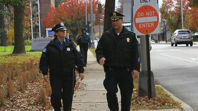 Morristown Police Chief Peter Demnitz, right, walks through town with an officer
