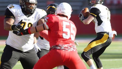 The Piscataway High School football team moves on offense during last year's sectional final against Manalapan.