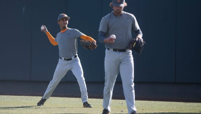 From left, University of Tennessee baseball pitchers Will Neely and Garrett Stallings warm up during practice at Lindsey Nelson Stadium on Friday, Jan. 26, 2018.
