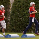 Here's Tom Brady at practice with a quarterback who actually has fewer fantasy points this season than he does: backup Jimmy Garoppolo.