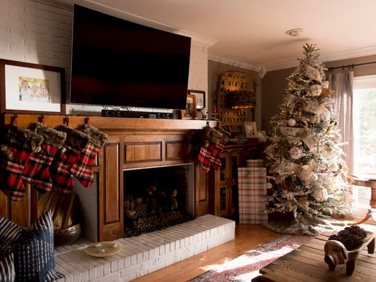 One of the home's Christmas trees occupies a corner