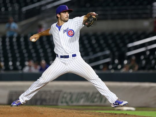 Dillon Maples delivers a pitch during a game with the Iowa Cubs.