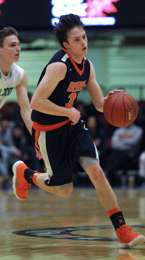 Briarcliff's Jack Ryan runs past Irvington's Chris