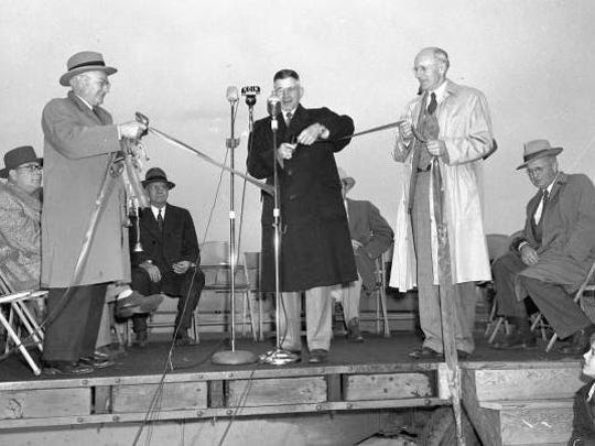 Gov. Douglas McKay (center) is seen at the microphone during the dedication ceremony of the Independence Bridge in December 1950.
