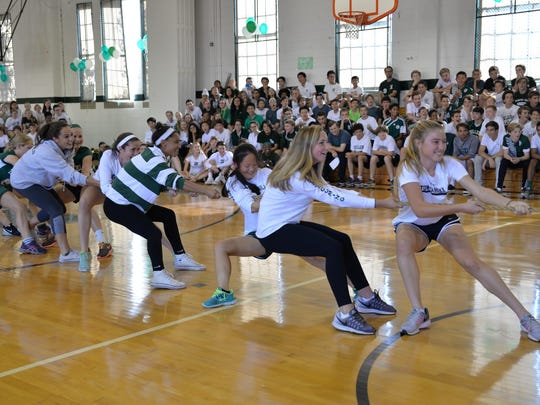 Tower Hill Field hockey players participate in a tug-of-war against members of the volleyball team.
