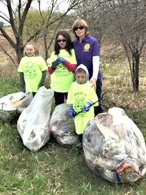 Middletown Lions Club member, Diane Youngs, and her family went out on Earth Day to clean up by the Orange Bank & Trust in Wallkill.