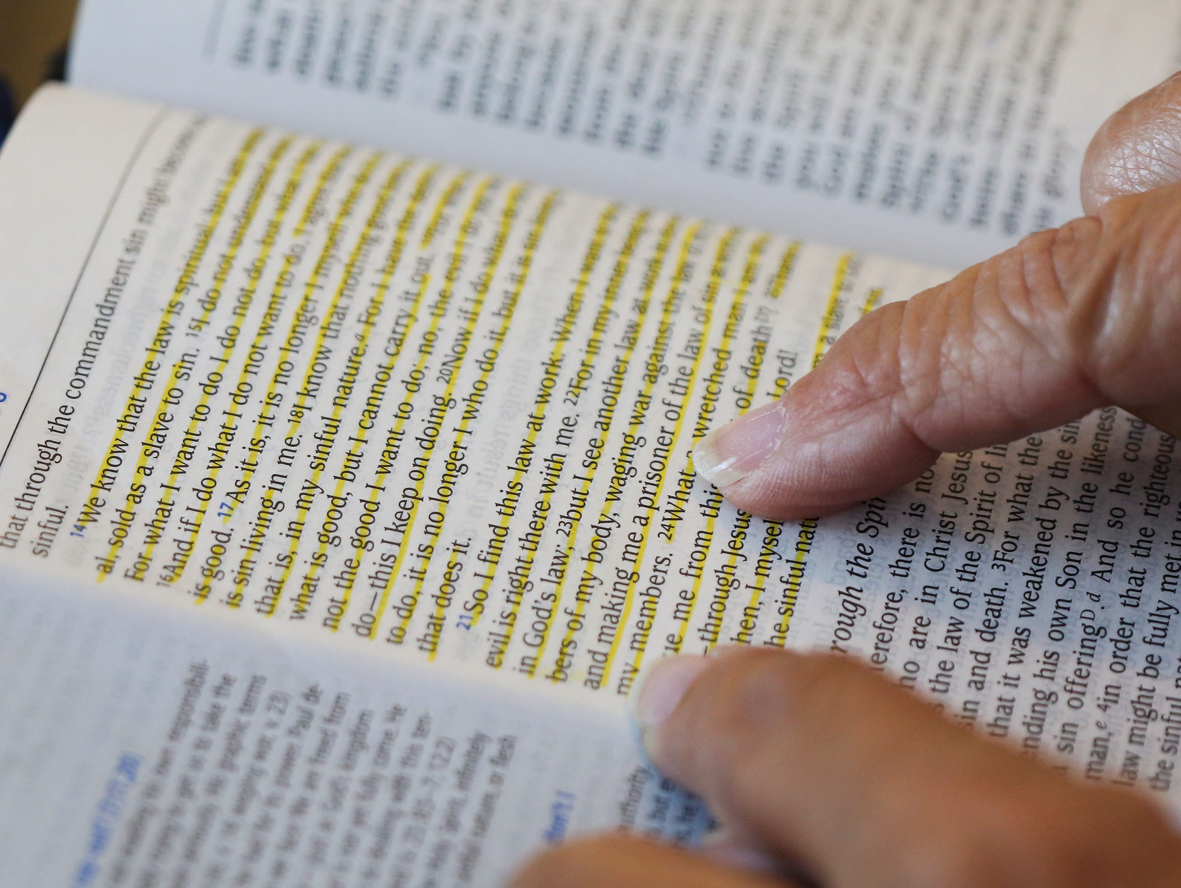 Brenda Cooley looks at a bible verse at her home.