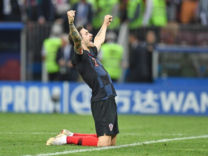 Croatia defender Sime Vrsaljko celebrates the win.