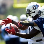 Titans wide receiver Dorial Green-Beckham (17) pulls in a pass as he is defended by cornerback B.W. Webb (38) during practice at Saint Thomas Sports Park on May 24, 2016.