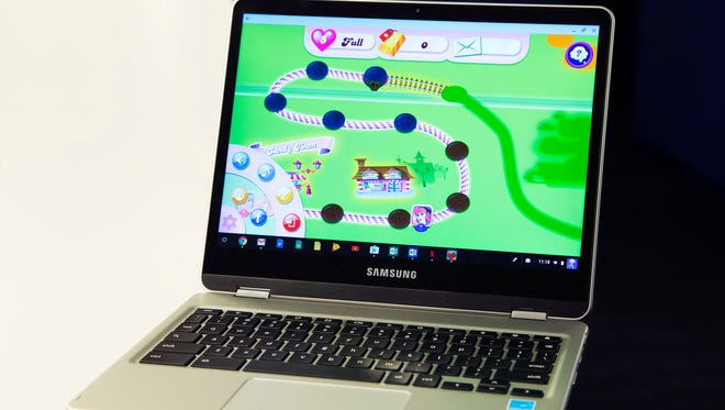 In this Feb. 8, 2017, photo, a Google Chromebook displays Candy Crush Saga in New York. Google Chromebook laptops are impractical for many people because they're little more than expensive paperweights when they're out of range of an internet connection. Yet they've defied expectations and made tremendous inroads in one of the least likely places: U.S. schools.