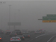 A traffic camera shows the dust storm shortly before