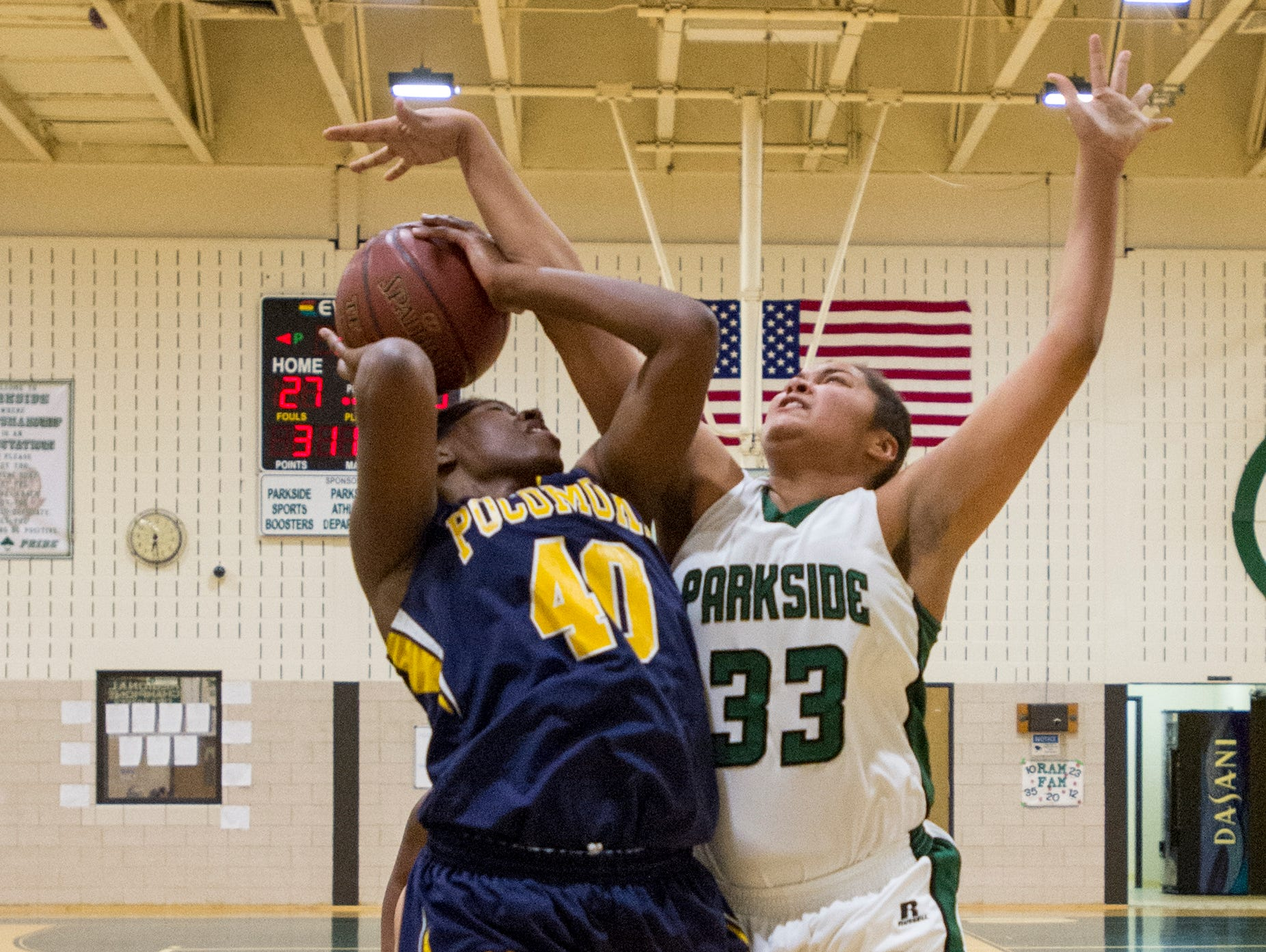 Pocomoke's Dynaisha Christian (40), left, goes up for a shot as Parkside's Kayla Handy (33) blocks during their game at Parkside Tuesday.