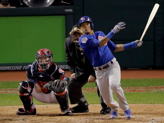 Chicago Cubs' Addison Russell watches his grand slam
