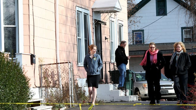 Members from the Monroe Crime Lab were at  22 Harvest St.  where six were arrested and charged with the kidnapping of two University of Rochester students.