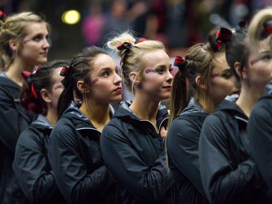 Southern Utah's gymnastics team listens to the national