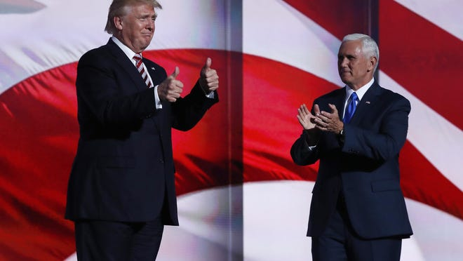 Republican Presidential Candidate Donald Trump arrives on stage to greet Republican Vice Presidential Nominee Gov. Mike Pence of Indiana during the third day session of the Republican National Convention in Cleveland, Wednesday, July 20, 2016. (AP Photo/Carolyn Kaster)