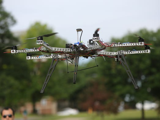 "An ""Octocopter"" made by University of Cincinnati Aerospace Engineering students Wei Wei and Bryan Brown on Thursday, June 19, 2014.  It's a prototype they're developing for a local company that eventually wants to use it to make remote deliveries off the roofs of delivery trucks."