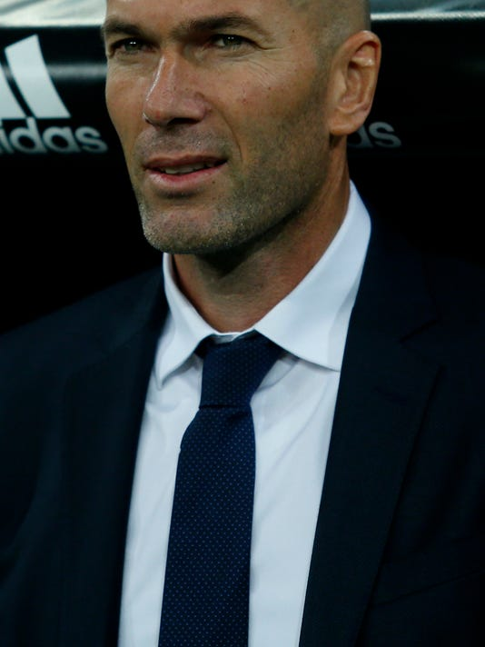 Real Madrid's new head coach Zinedine Zidane waits for the start of the game prior a Spanish La Liga soccer match between Real Madrid and Deportivo Coruna at the Santiago Bernabeu stadium in Madrid, Saturday, Jan. 9, 2016. Real Madrid won 5-0. (AP Photo/Francisco Seco)