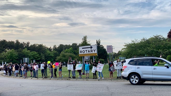 Hundreds line the Mashpee Rotary on Wednesday to protest the death of George Floyd in Minneapolis police custody.