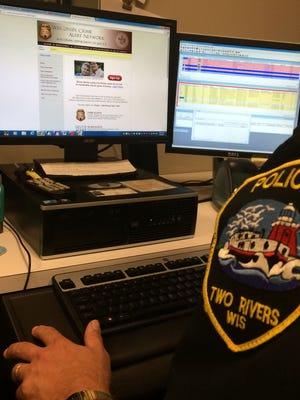 Lt. Gary Sheahan of the Two Rivers Police Department opens up a link to the Wisconsin Crime Alert Network which has recently added a Silver Alert program to find missing senior adults who have Alzheimer's, dementia or other permanent cognitive impairments.