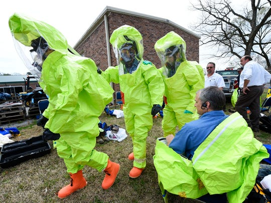 Personnel move into position to enter the building during a HazMat training exercise that simulated a chlorine leak at West Wilson Utility's water treatment plant on Beth Dr
