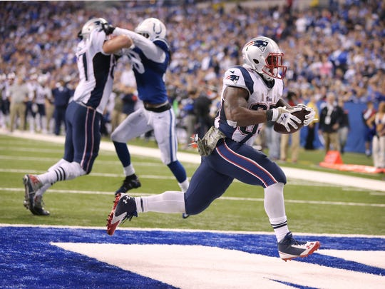 New England Patriots running back Jonas Gray scrambles in for his fourth touchdown against the Colts. Indianapolis hosted New England at Lucas Oil Stadium on Sunday, November 16, 2014.