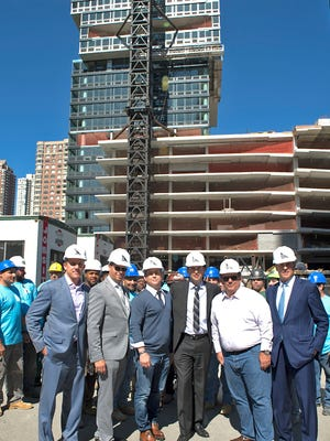 At 713 feet, Harborside 1 recently was declared the state's tallest residential building. Jersey City Mayor Steven Fulop and other officials participated in a celebration of the construction milestone.