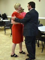 Union County Judge Executive Adam O'Nan, right,  chats with Superintendent Sheffer following Beshear's announcement.