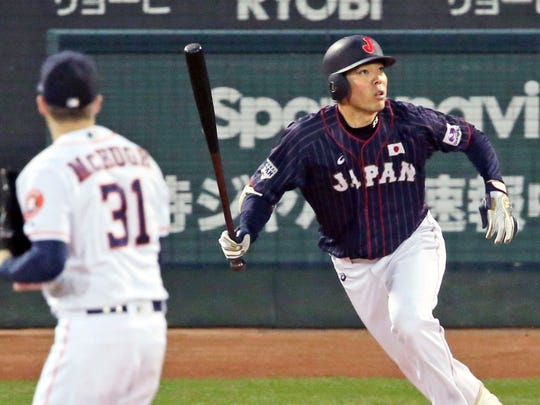 All Japan's Shogo Akiyama, right, hits an inside-the-park home run off MLB All-Star pitcher Collin McHugh (31) of the Houston Astros in the eighth inning of Game 4 at their All-Stars Series baseball at Mazda Zoom-Zoom Stadium in Hiroshima, western Japan, Tuesday, Nov. 13, 2018. (Kyodo News via AP)
