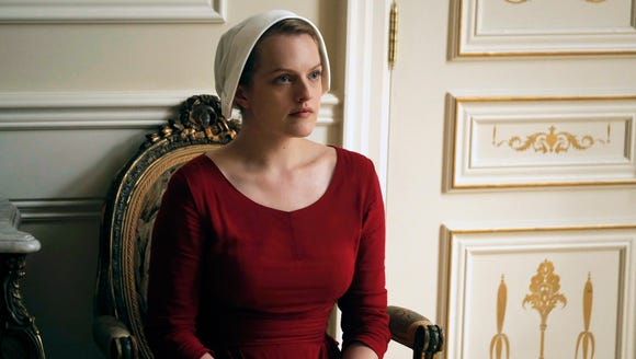 "Elisabeth Moss as Offred in a scene from Hulu's ""The"