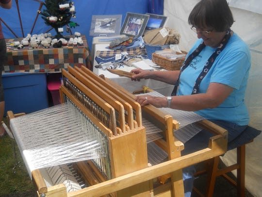 Artisans demonstrate traditional crafts at the Frontier