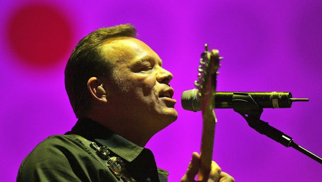 British band UB40 lead singer Ali Campbell, performs at the Live Earth concert, a 24-hour global concert series to raise awareness about climate change, at the Dome in Johannesburg, South Africa, in this July 7, 2007, file photo. Campbell said Friday he has quit pop-reggae band UB40 after almost 30 years, citing management problems. His bandmates, however, said the 48-year-old singer left to pursue solo projects.