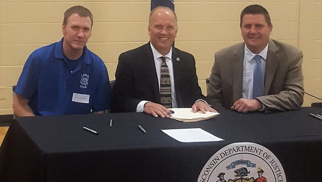 Lena buildings and grounds director/project manager Jeff Hermersmann, left, and Lena superintendent Ben Pytleski accepted a state School Safety Grant from Attorney General Brad Schimel in Appleton on June 21.