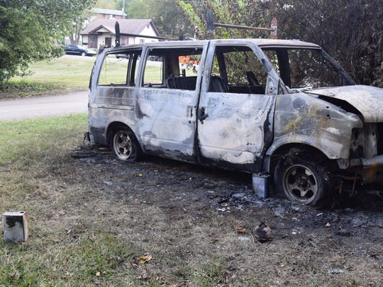 Pictured is the van residents say someone incinerated early Saturday. The van was parked outside the home at the corner of Ben Hur Avenue and Selma Drive where a man was fatally shot on Sunday.