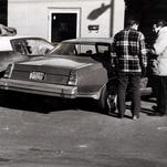 New York State Police investigators check the crime scene at a Corning car wash in 1980 where investigator Robert Van Hall and investigator William Gorenflo were ambushed while inside the vehicle on the left. Van Hall died, and Gorenflo was severely injured. Brothers Joseph and Larry Comfort were convicted in the shooting.