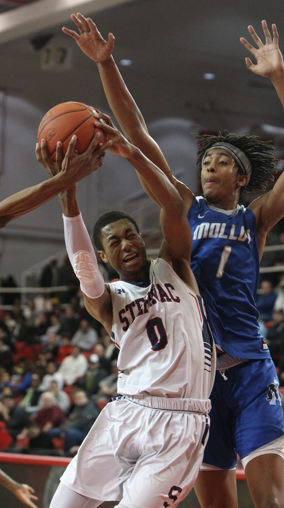 Stepinac's Alan Griffin is pressured by Molloy's Moses